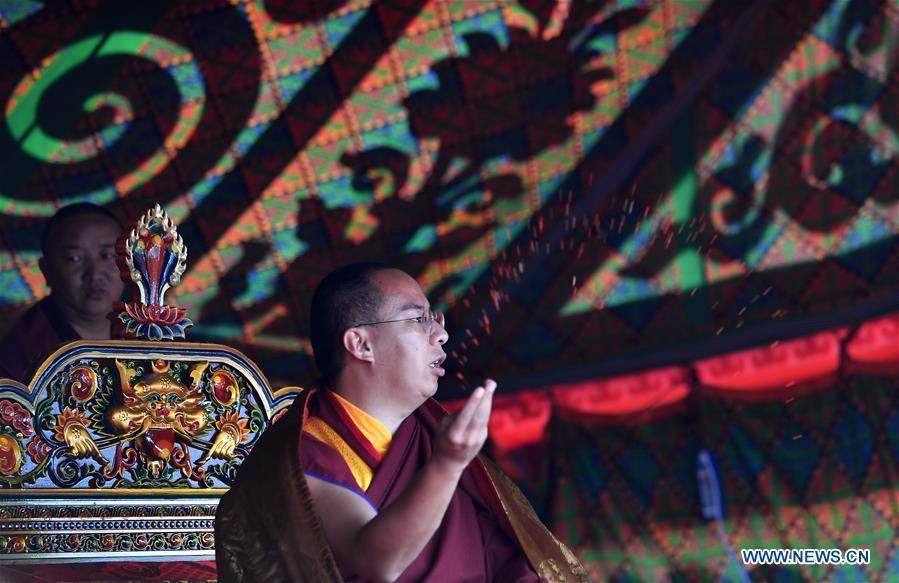 11th Panchen Lama worships on bank of Nam Co Lake in China's Tibet