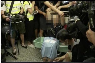 记者遭香港暴徒殴打环球网:对,这是我们的记者和英雄!
