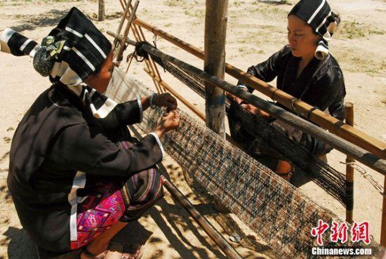 """女摄影家用影像""""抢救""""海南本土民俗文化"""