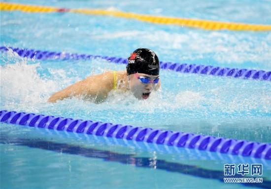 (军运会)(8)游泳――女子100米蝶泳:中国选手张雨霏夺冠