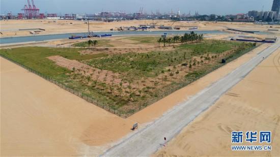 """(国际・图文互动)(8)通讯:""""五年我们为斯里兰卡造出一片新土地""""――科伦坡港口城人的自豪与希冀"""