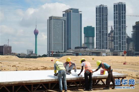 """(国际・图文互动)(5)通讯:""""五年我们为斯里兰卡造出一片新土地""""――科伦坡港口城人的自豪与希冀"""
