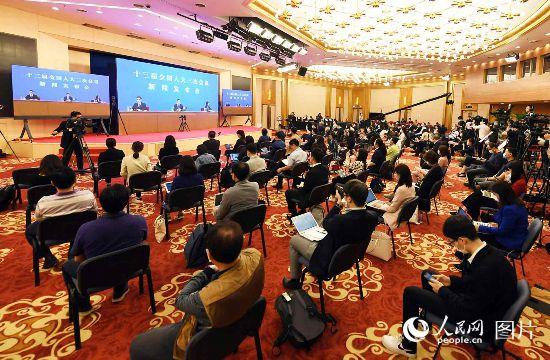 十三屆全國人大三次會議新聞發布會記者雲提問。人民網記者 翁奇羽 攝