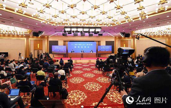 十三屆全國人大三次會議新聞發布會現場。人民網記者 翁奇羽 攝