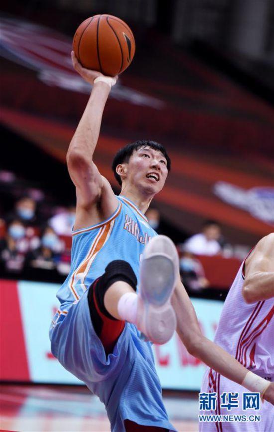 (体育)(7)篮球――CBA复赛第一阶段:新疆伊力特胜青岛国信双星
