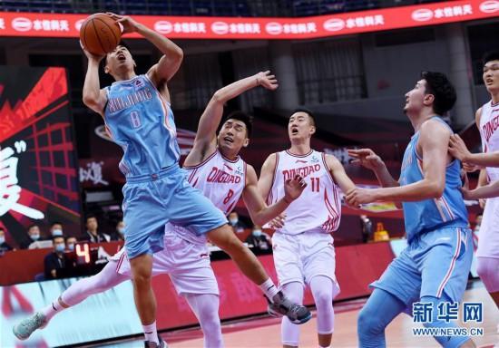 (体育)(9)篮球――CBA复赛第一阶段:新疆伊力特胜青岛国信双星