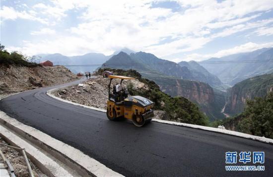 (圖文互動)(5)我國最后一個具備條件通硬化路的建制村阿布洛哈村通車了