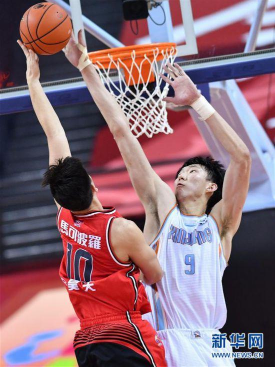 (体育)(7)篮球――CBA复赛第二阶段:新疆伊力特胜深圳马可波罗