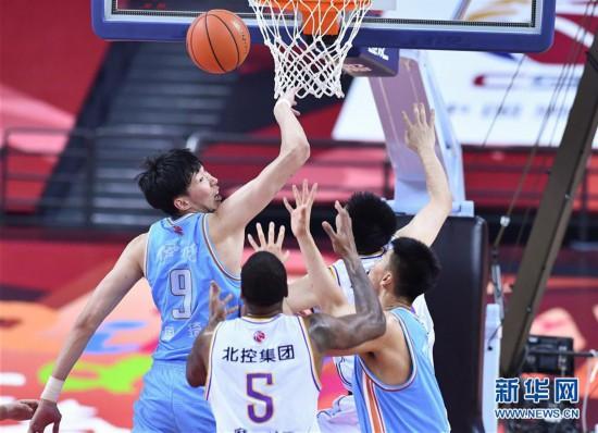(体育)(7)篮球――CBA复赛第二阶段:新疆伊力特胜北京控股