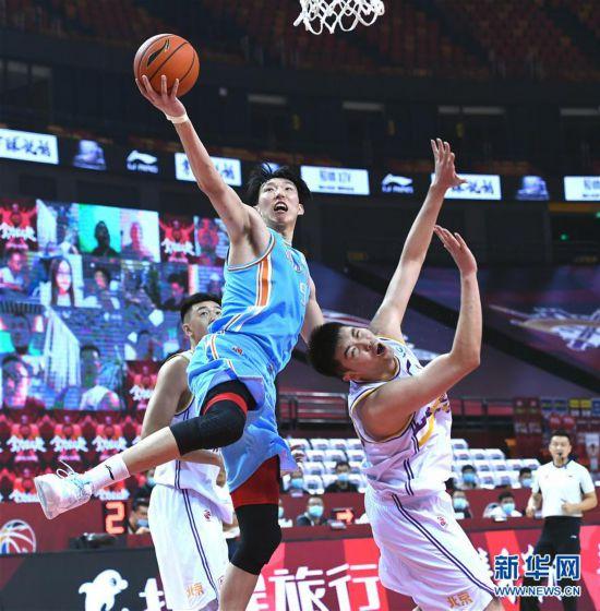(体育)(12)篮球――CBA复赛第二阶段:新疆伊力特胜北京控股