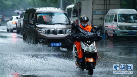 (社会)(1)北京迎来降雨
