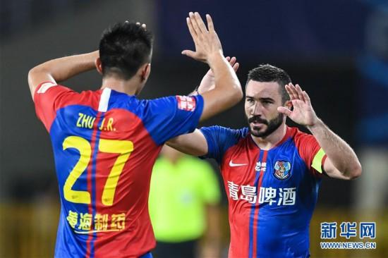 (体育)(6)足球――中超:北京中赫国安战平青岛黄海青港