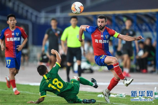 (体育)(15)足球――中超:北京中赫国安战平青岛黄海青港