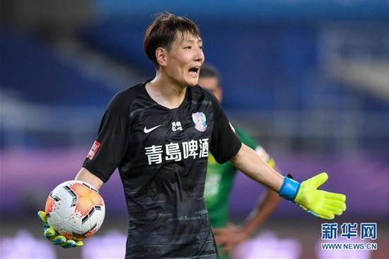 (体育)(18)足球――中超:北京中赫国安战平青岛黄海青港