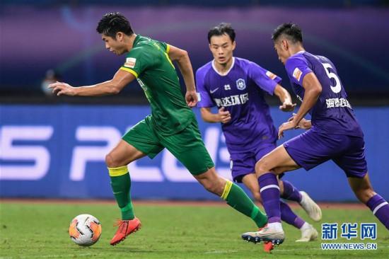 (体育)(3)足球――中超:北京中赫国安胜天津泰达