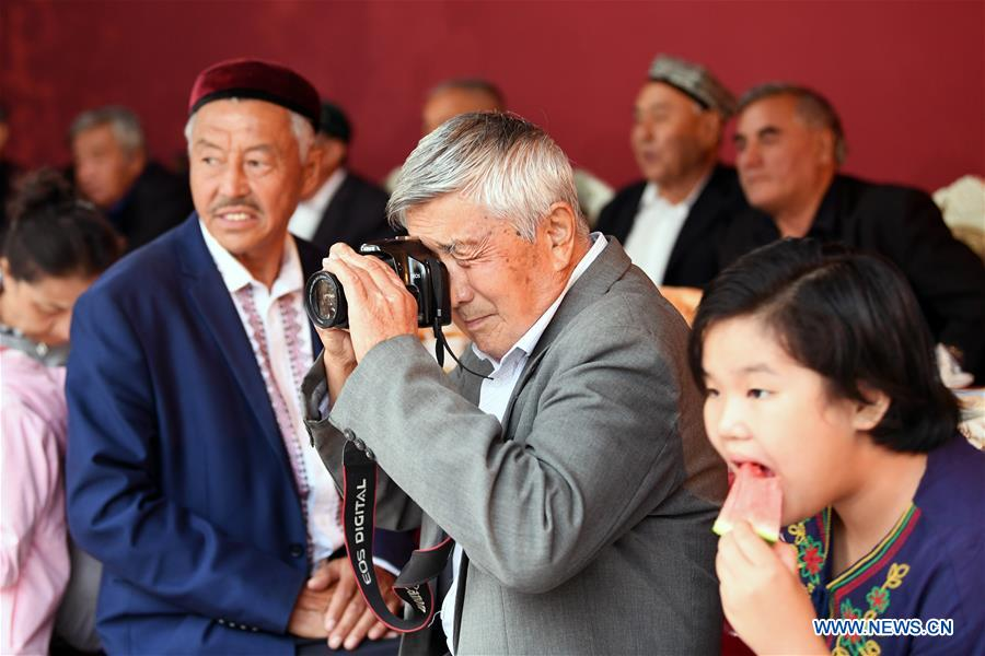 Residents attend feast in Tacheng, northwest China's Xinjiang