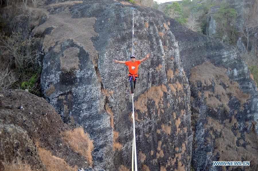 In pics: rope walk at height of 740 meters on Mount Nglanggeran in Indonesia