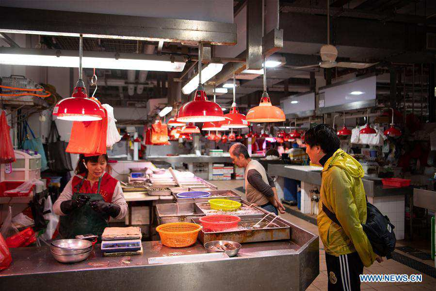Pic story: local fishmonger witnesses great changes in Macao in past 20 years