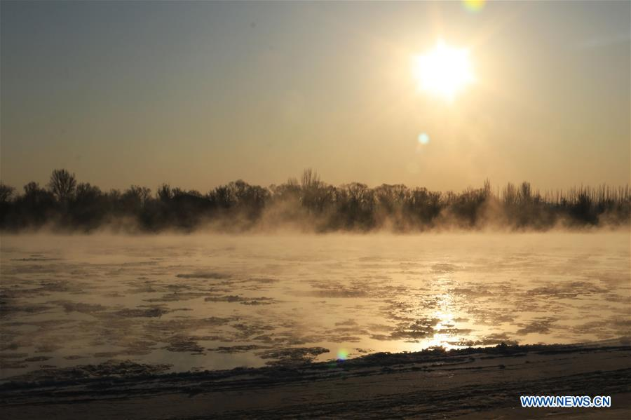 Mist-shrouded Yellow River in China's Inner Mongolia