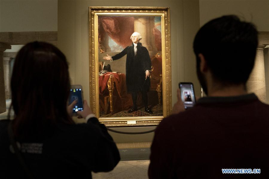 "Visitors view portraits during exhibition ""America's Presidents"" in Washington"