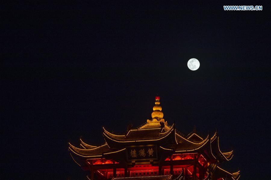 Moon rises behind Yellow Crane Tower, landmark of Wuhan