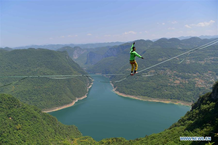 Man balances on highline at outdoor sports base in Hubei