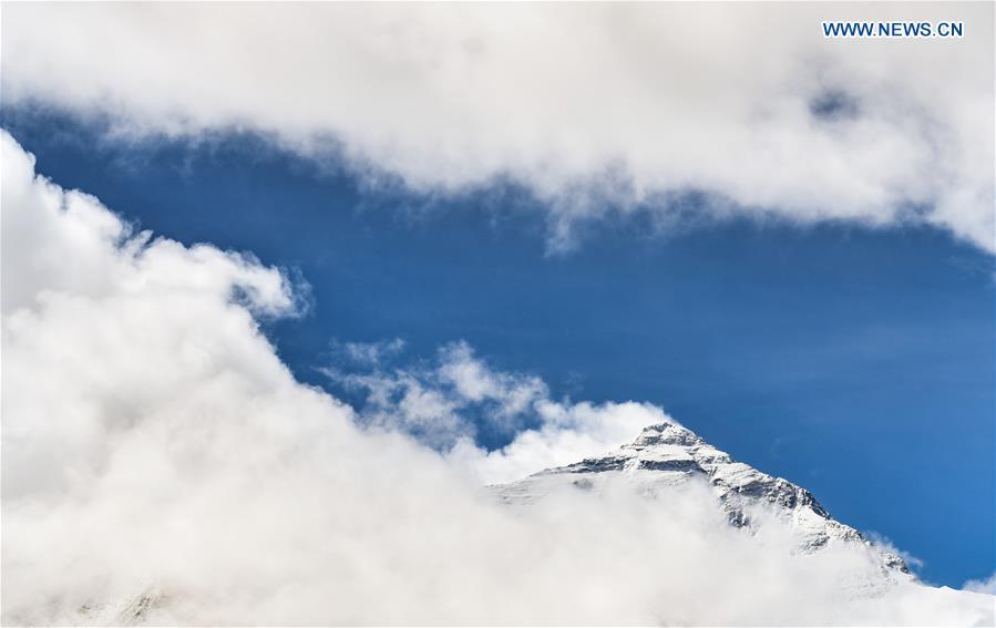 View of Mount Qomolangma amid cloud