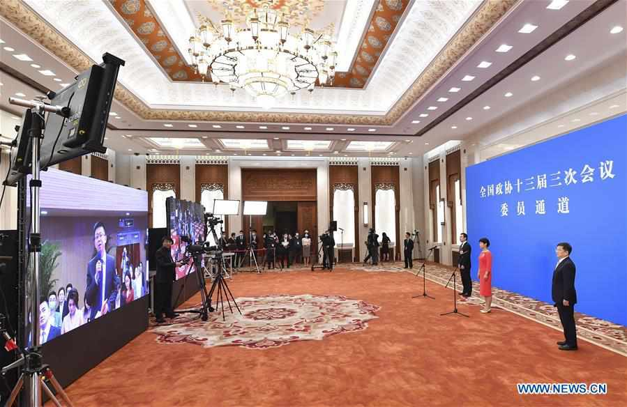 CPPCC members receive interview before closing meeting of annual session