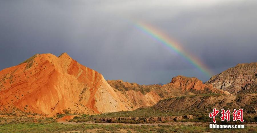 Rainbow over 'Alien Valley' in Zhangye, Gansu