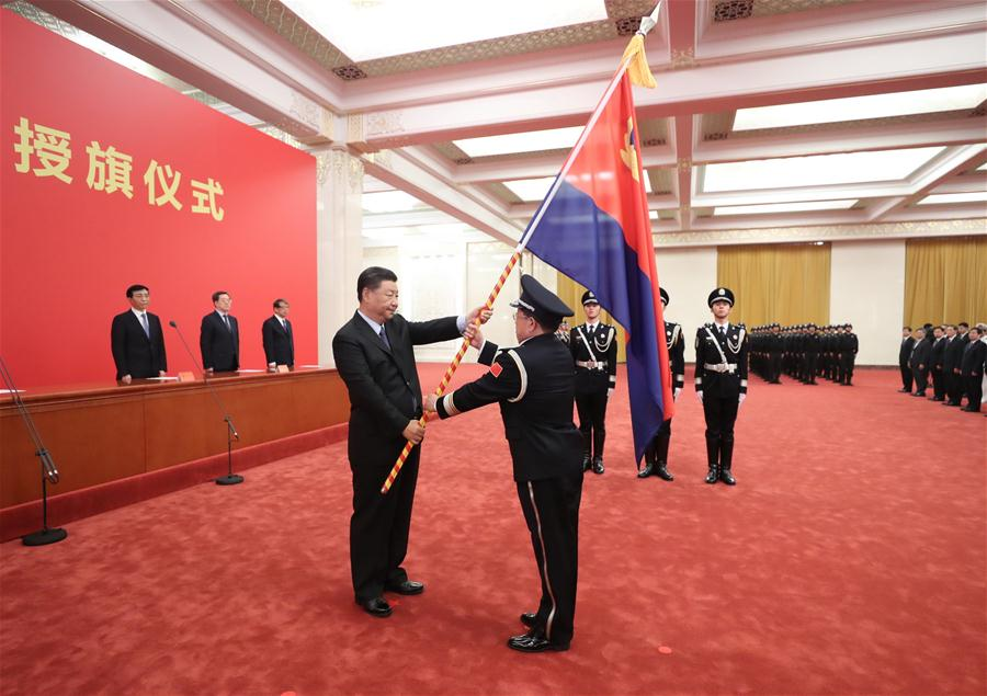Xi confers flag on China's police force