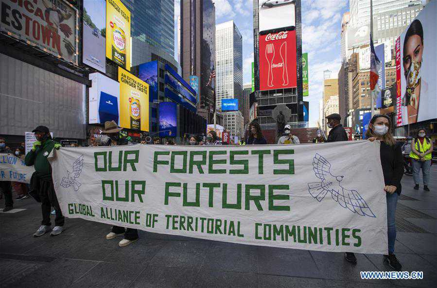 People take part in climate change protest in New York