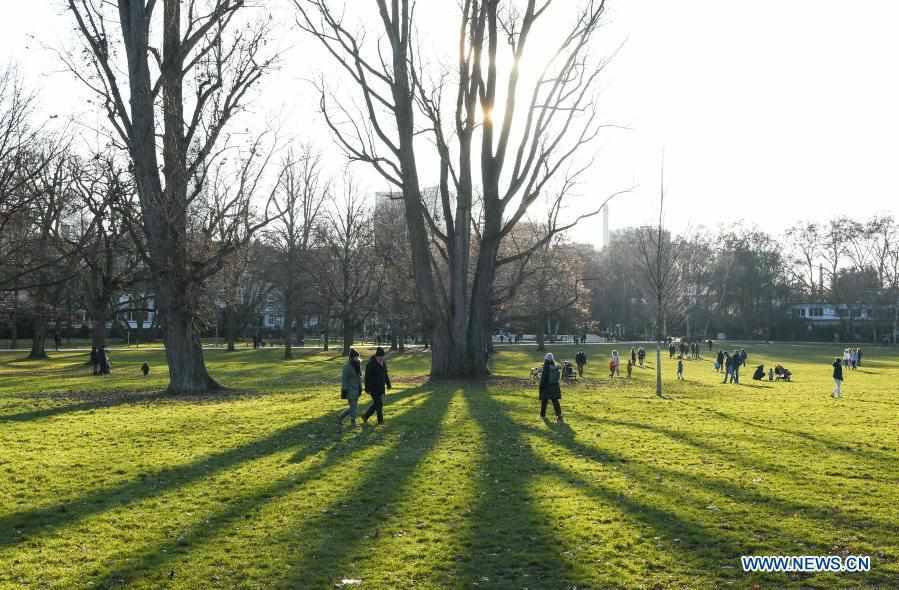 People enjoy sunshine at park in Frankfurt, Germany
