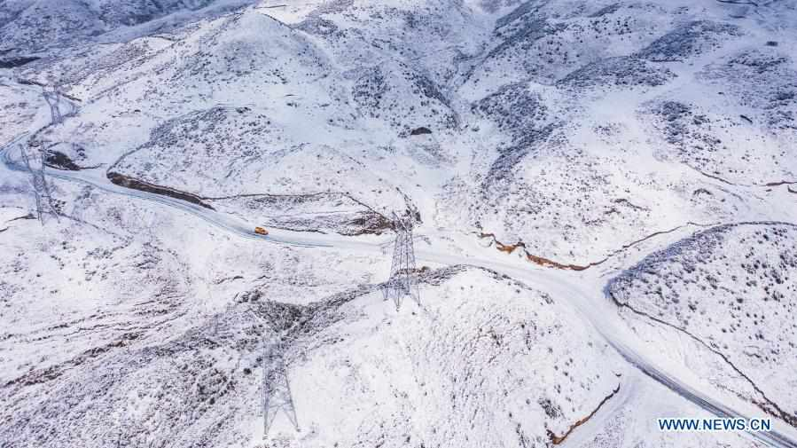 Staff check power grid after continuous snowfall in Liupanshui, SW China