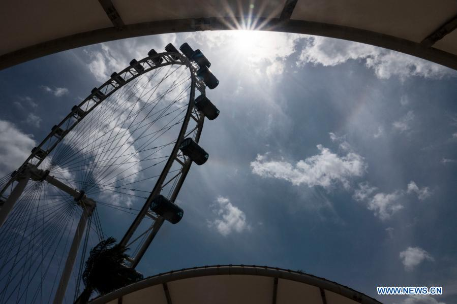 Sun halo appears in sky above the Singapore Flyer