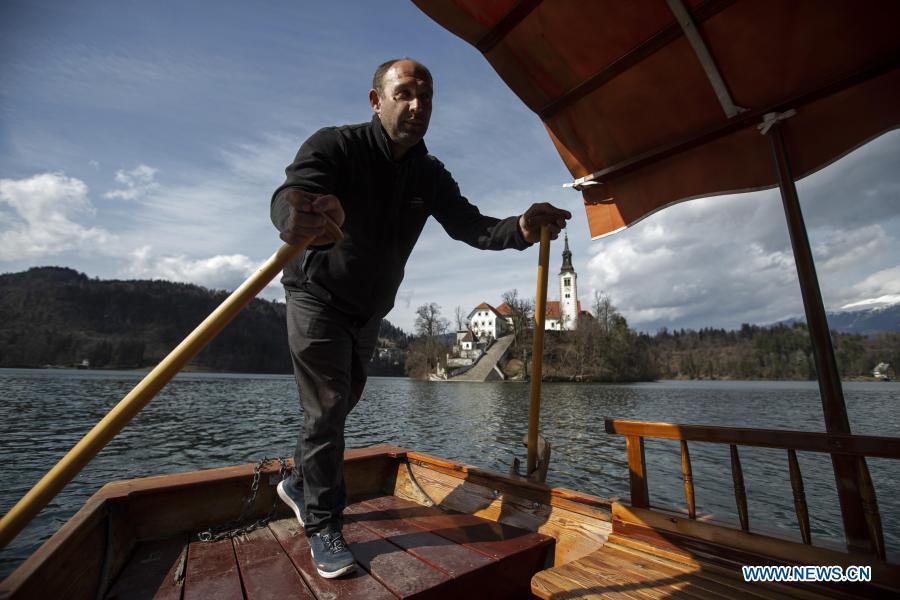 "Bruised by coronavirus, Slovenian boatmen restore ""pletna"" for tourist comeback"