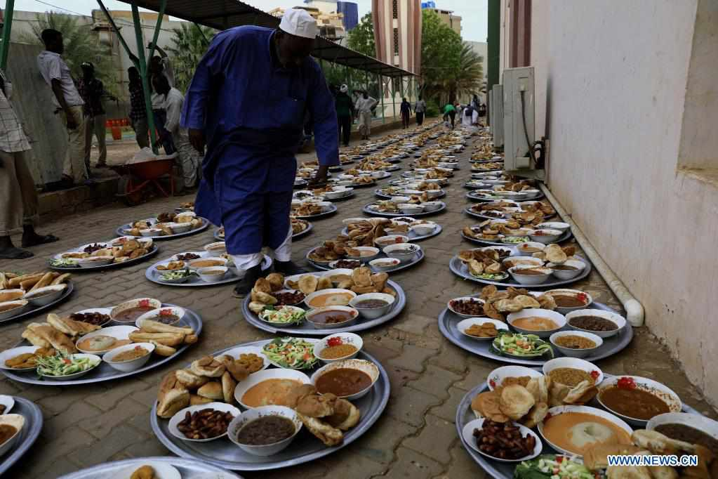 People have iftar on street during Islamic holy month of Ramadan in Sudan