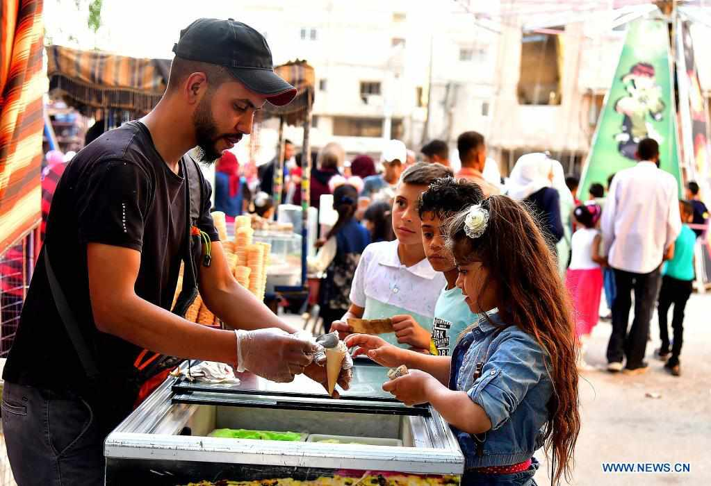 People enjoy festive atmosphere of Eid al-Fitr feast in Damascus, Syria
