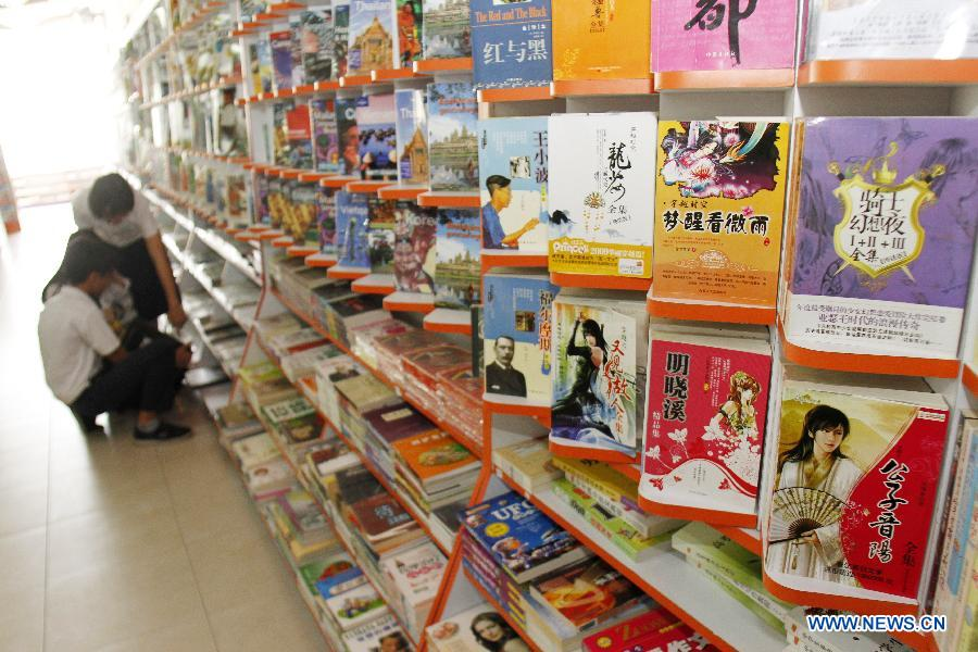 Chinese books are on display during a Chinese book fair in Phnom Penh, Cambodia, Oct. 27, 2014.