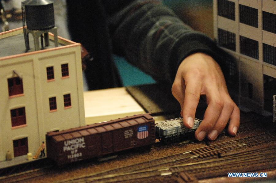 An exhibitor prepares model trains to run during the 32nd Model Railway Exhibition 'Trains 2014' in Burnaby, Canada, Nov. 8, 2014.