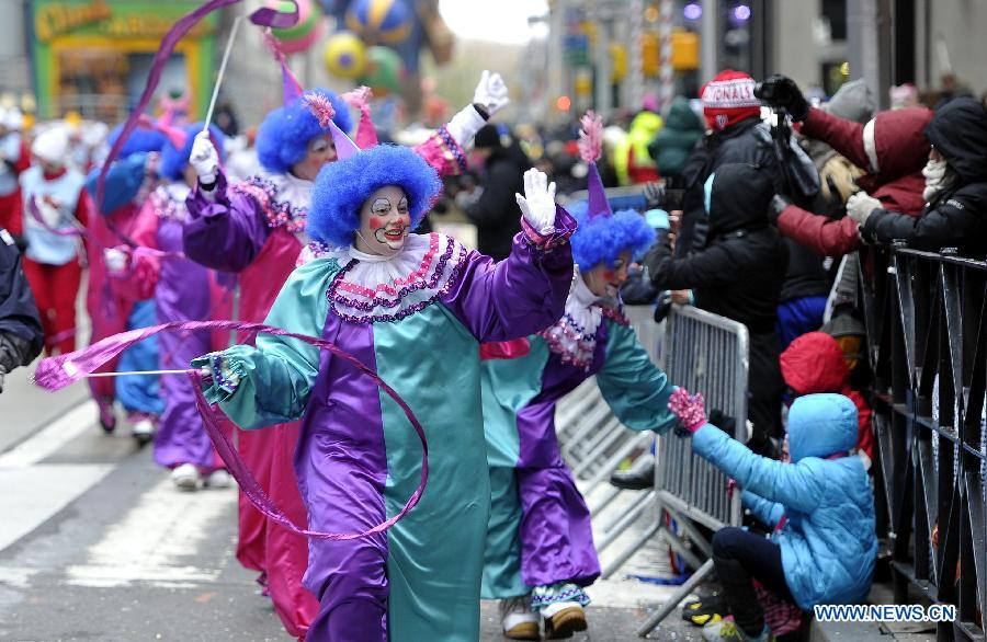 People attend the 88th Macy's Thanksgiving Day Parade in New York, the United States, Nov. 27, 2014.