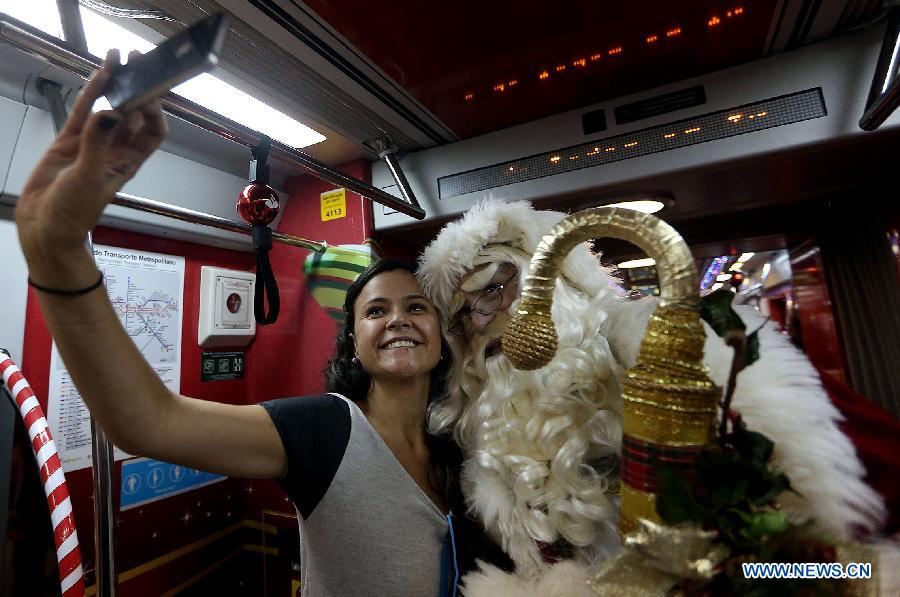 An actor disguised as Santa Claus travels in a wagon of the Sao Paulo Metro Yellow Line, in the city of Sao Paulo, Brazil, on Dec. 1, 2014.