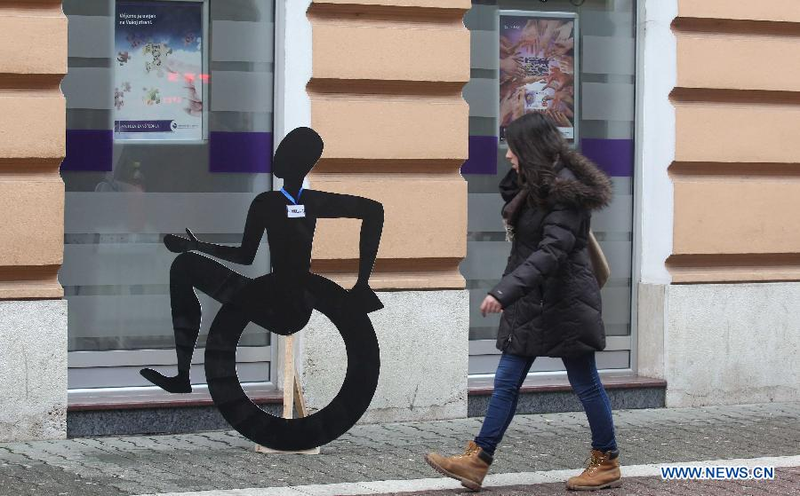 Art installments depicting disabled people are seen on the street of Banja Luka, Bosnia and Herzegovina, on Dec. 3, 2014. The International Day of People with Disability is observed on Wednesday to promote an understanding of disability issues and mobilize support for the dignity, rights and well-being of persons with disabilities.