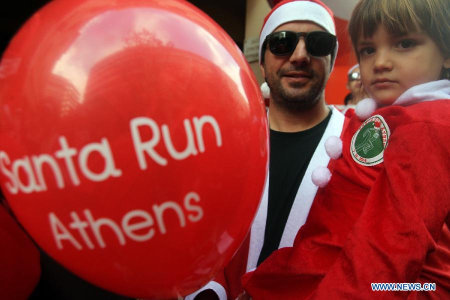 Runners wearing Santa Claus suits attend the first 'Santa Run' race in Athens, capital of Greece, on Dec. 7, 2014.