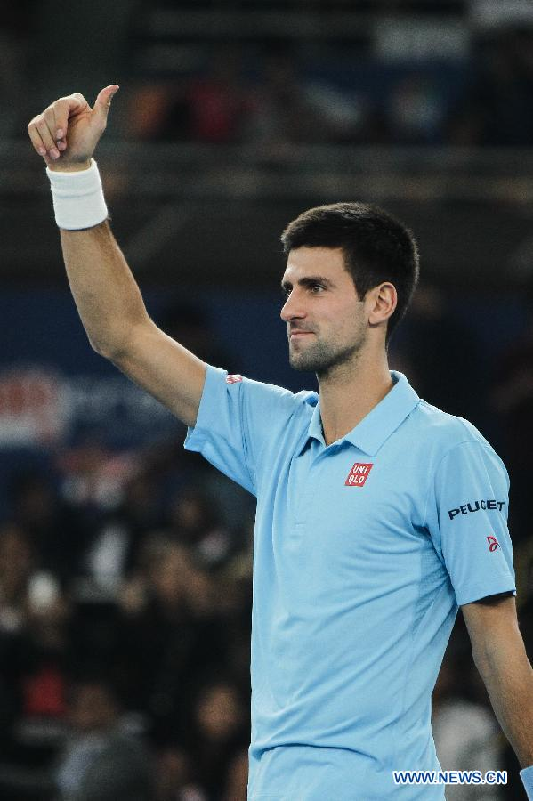 Novak Djokovic of UAE Royals reacts during the match against Roger Federer of Indian Aces at the Indian Leg of the International Premier Tennis League in New Delhi, India, Dec. 8, 2014. UAE Royals won 29-22. (Xinhua/Zheng Huansong)