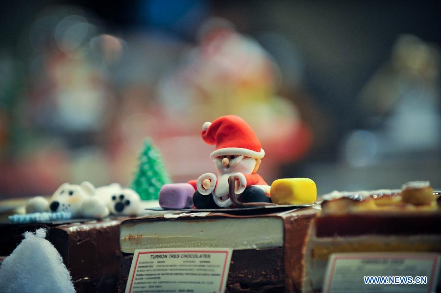 A Christmas decoration is seen in a shop window in Madrid, Spain on Dec. 11, 2014.
