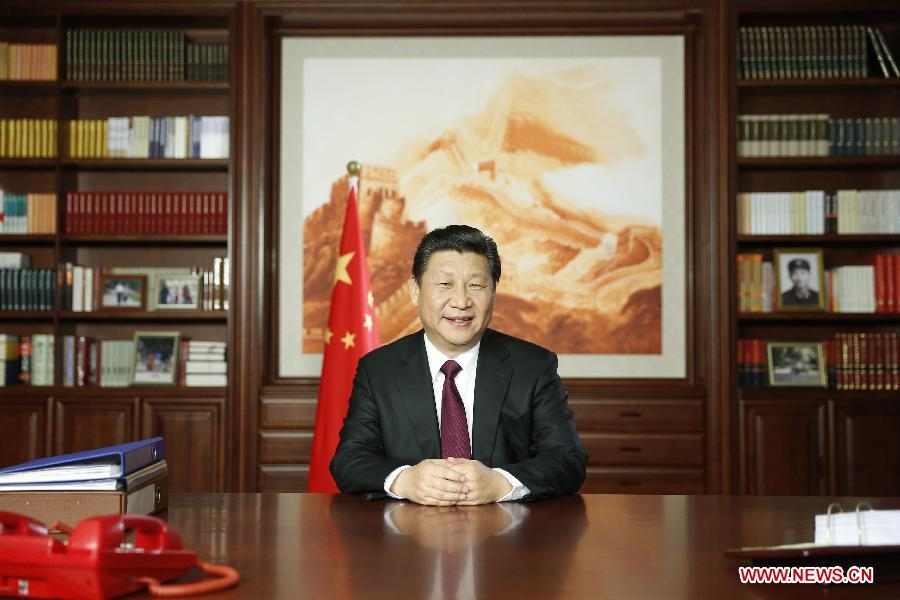 Chinese President Xi Jinping delivers his New Year speech via state broadcasters, in Beijing, capital of China, Dec. 31, 2014. (Xinhua/Ju Peng)
