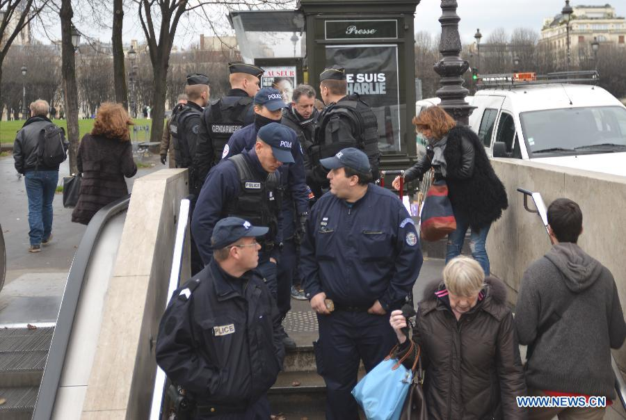 Police walk into a metro station in Paris, France, Jan. 8, 2015. Paris is beefing up security in precaution after Wednesday's deadly terrorist which left 12 people killed and 11 others injured.