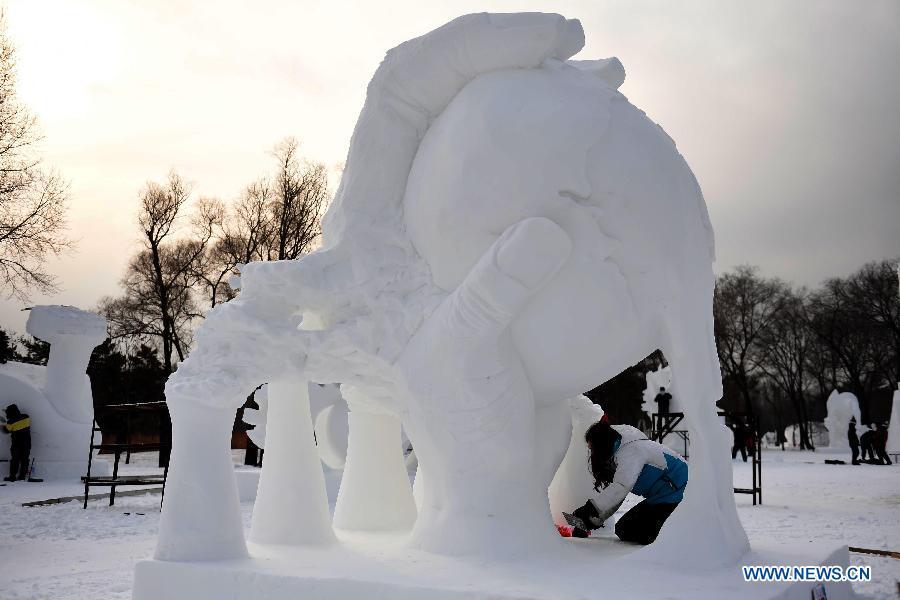 British snow sculpture is seen at the 20th Harbin International Snow Sculpture Contest in Harbin, capital of northeast China's Heilongjiang Province, Jan. 13, 2015.