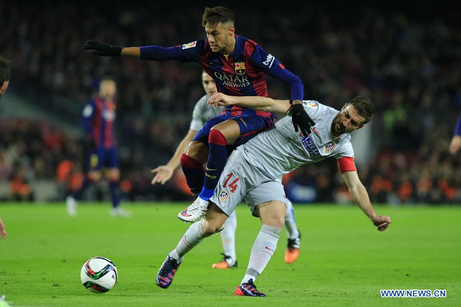 Barcelona's Brazilian forward Neymar competes during the King's Cup quarter-final first leg soccer match against Atletico Madrid at the Nou Camp stadium in Barcelona Jan. 21, 2015.
