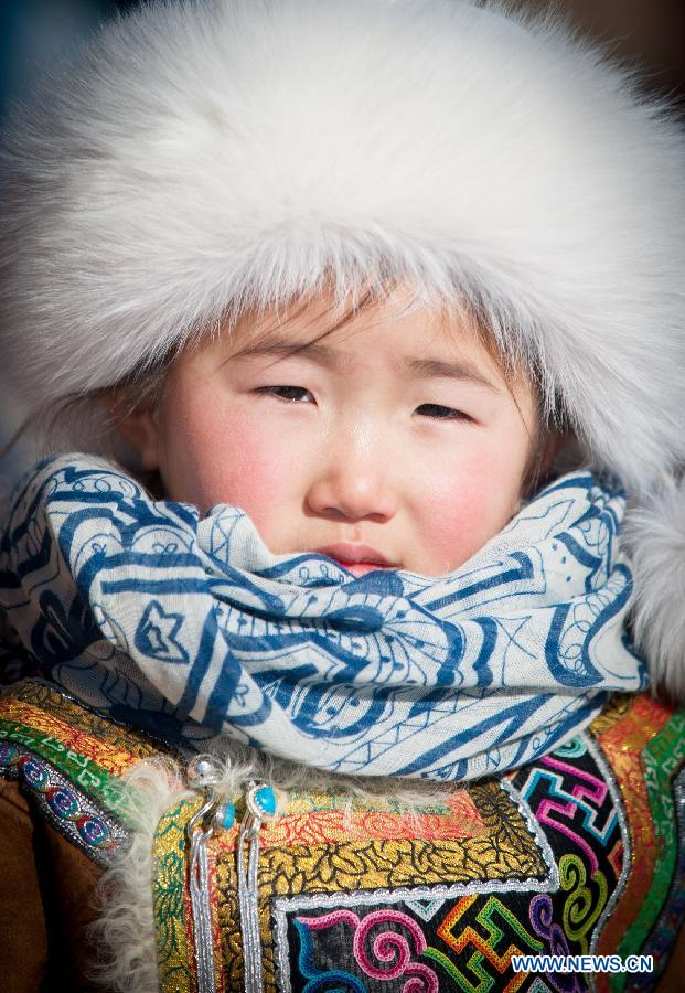 A girl of Mongolian ethnic group is seen during a winter Nadam in East Ujimqin Banner, north China's Inner Mongolia Autonomous Region, Jan. 21, 2015.